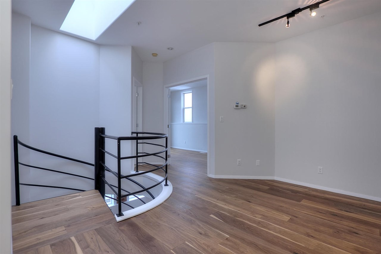 The upper level loft is at the top of the spiral staircase and represents a great space for a den or sitting area.