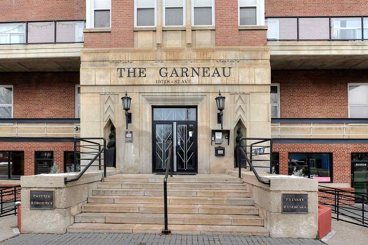 The Garneau is a massive red brick building in an early modernist style and has six historic stories with a projecting central pavilion frontispiece.