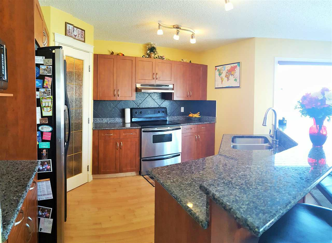 Kitchen with NEW granite counter tops and stainless steel appliances!