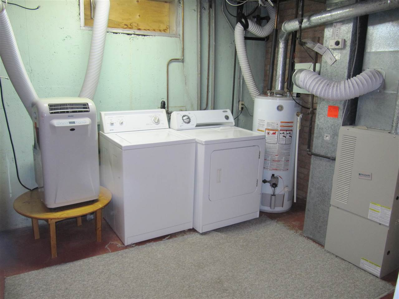HUGE laundry room located in basement with LOTS of storage