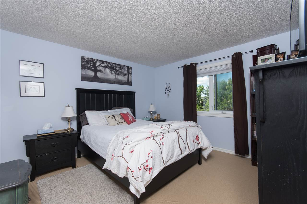 The master bedroom is large enough for a king sized bed and ample furniture.