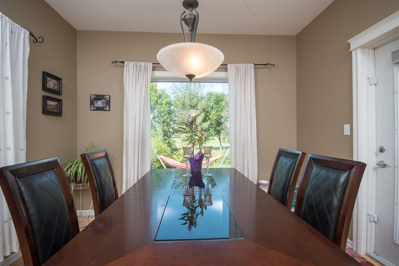 The dining room is located conveniently next to the kitchen with large windows to look out into your big back yard and golf course!