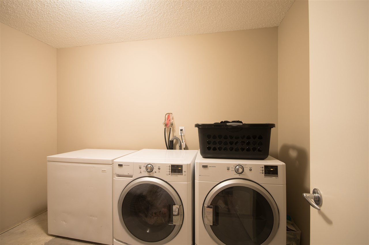 Laundry room features front load washer/dryer set