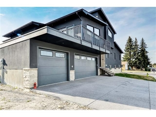 Main Photo: 1103 40 Street SW in Calgary: Rosscarrock House for sale : MLS®# C4059738