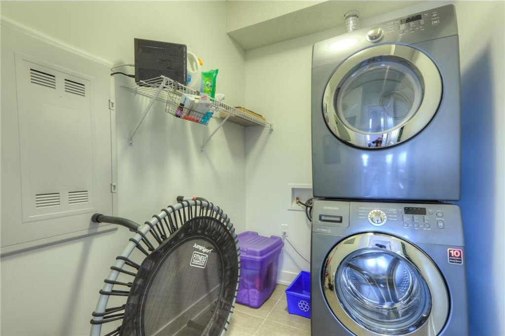 In-suite washer/dryer with additional storage space.