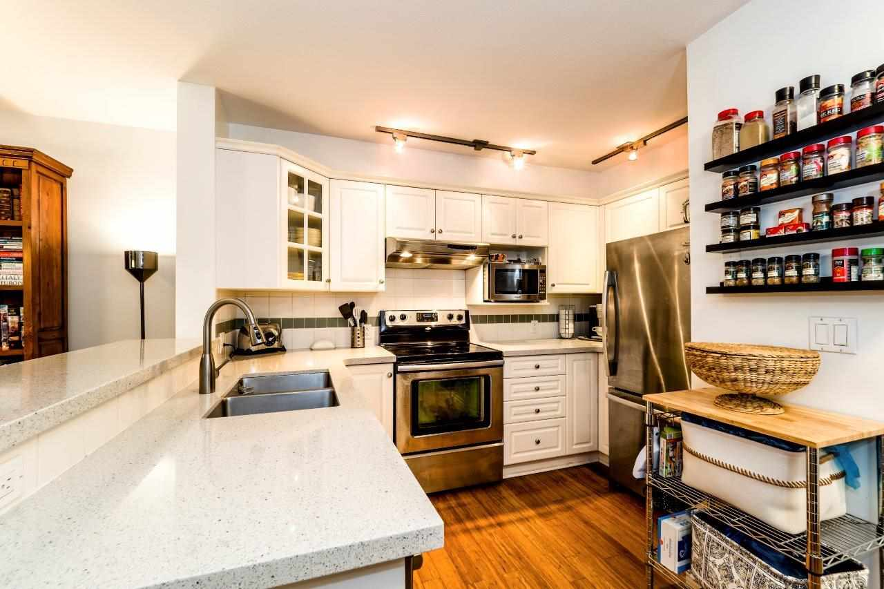 "Photo 3: Photos: 113 155 E 3RD Street in North Vancouver: Lower Lonsdale Condo for sale in ""The Solano"" : MLS® # R2244592"