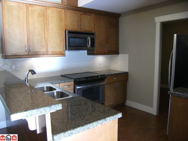 "Photo 6: 307 15368 17A Avenue in Surrey: King George Corridor Condo for sale in ""Ocean Wynde"" (South Surrey White Rock)  : MLS(r) # F1127499"