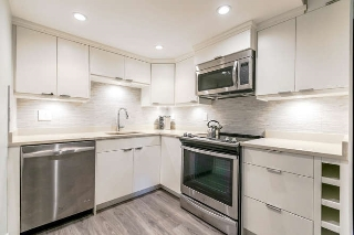 "Main Photo: 107 215 N TEMPLETON Drive in Vancouver: Hastings Condo for sale in ""PORTO VISTA"" (Vancouver East)  : MLS(r) # R2155798"