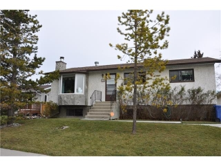 Main Photo: 204 Frontenac Avenue: Turner Valley House for sale : MLS® # C4078819