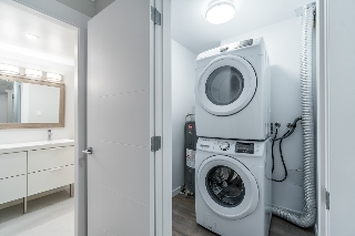 Laundry room with new washer/dryer and extra storage area