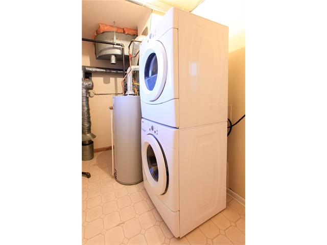 Utility room in the rear of unit, all units provide in-suite washer/dryer for added comfort for the tenants.