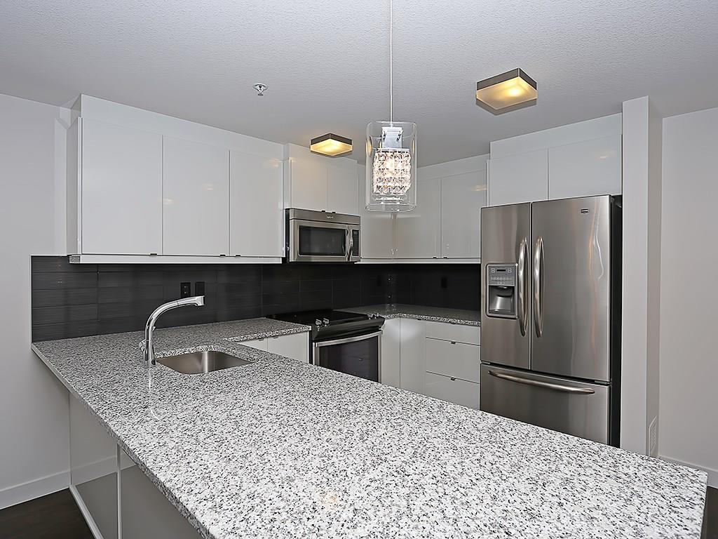 Main Photo: 209 45 Aspenmont Heights SW in Calgary: Aspen Woods Condo for sale : MLS(r) # C4126243