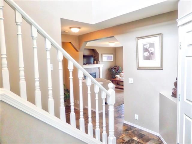Photo 8: 1010 BRIDLEMEADOWS Manor SW in Calgary: Bridlewood House for sale : MLS(r) # C4065914