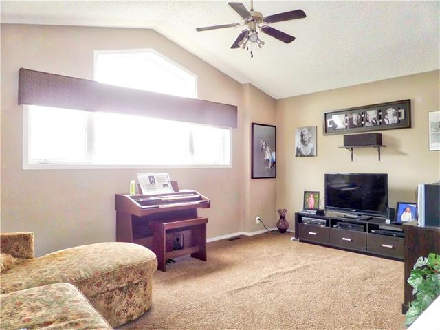 Photo 22: 1010 BRIDLEMEADOWS Manor SW in Calgary: Bridlewood House for sale : MLS(r) # C4065914
