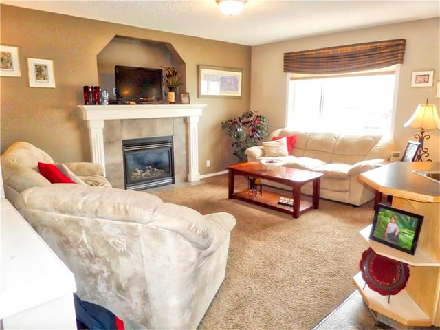 Photo 9: 1010 BRIDLEMEADOWS Manor SW in Calgary: Bridlewood House for sale : MLS(r) # C4065914
