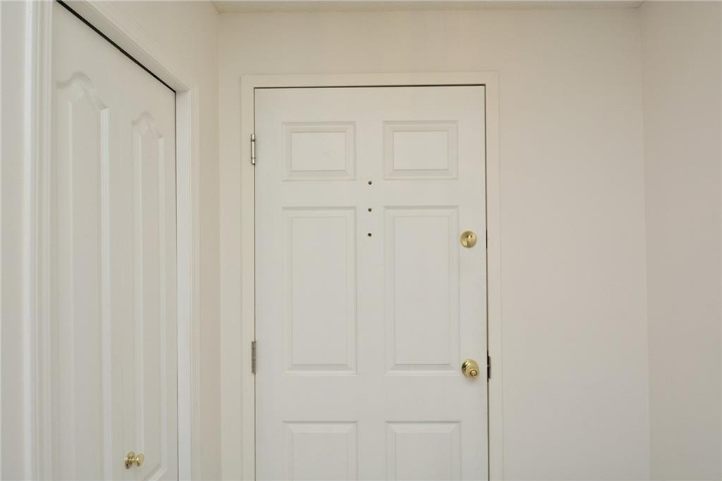This is the entry way of this unit. There is lots of closet space here, too.