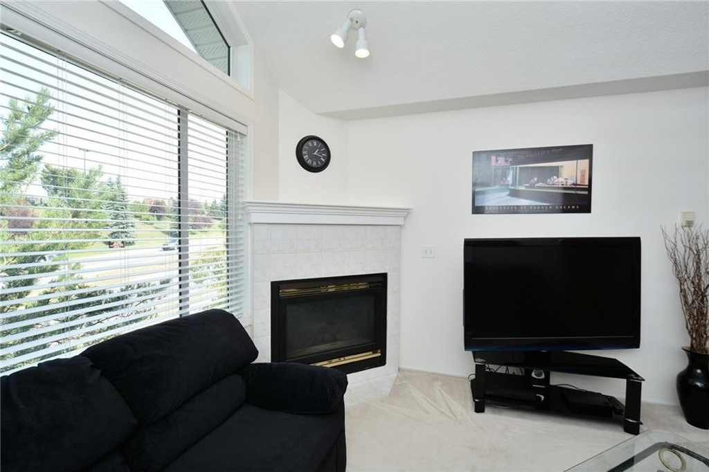 Notice the corner, gas fireplace.