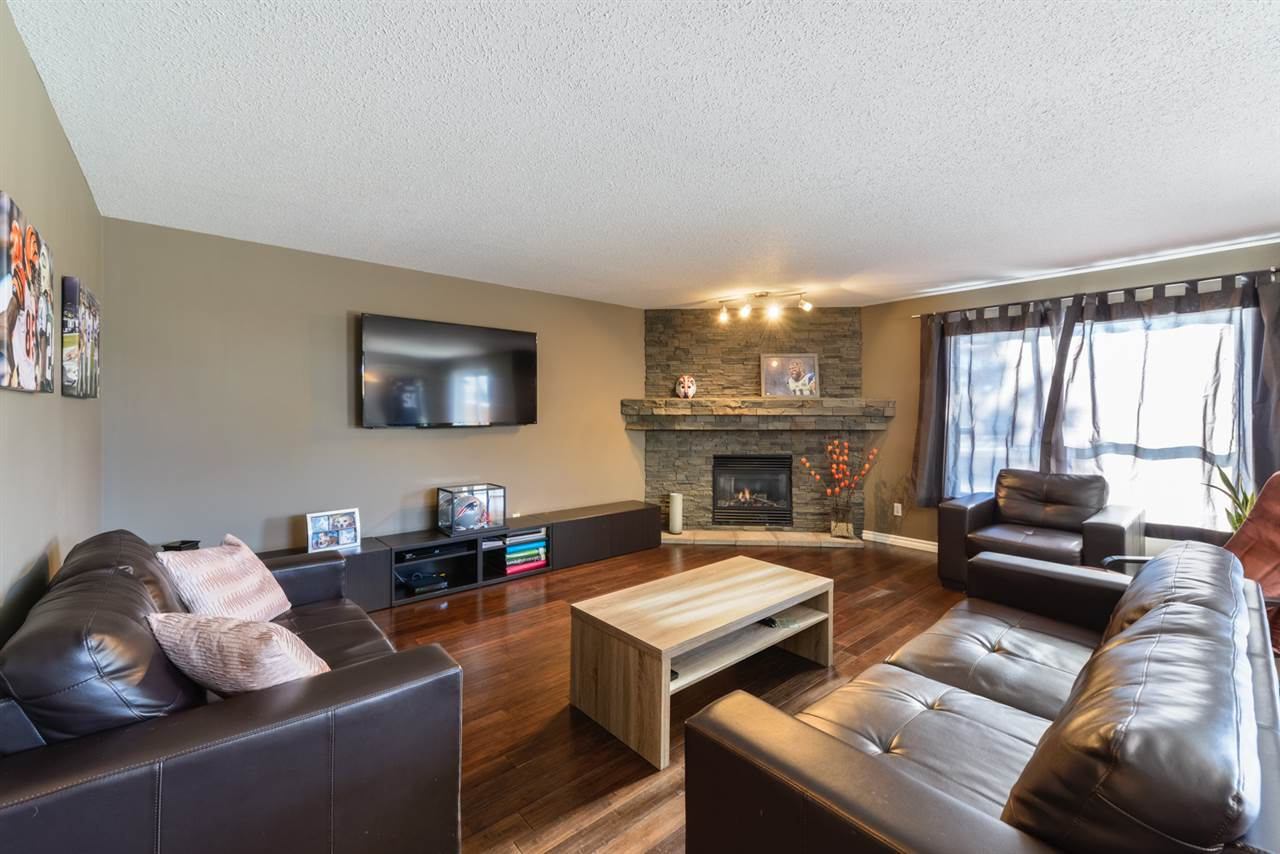 Spacious basement features large family room and bedroom.