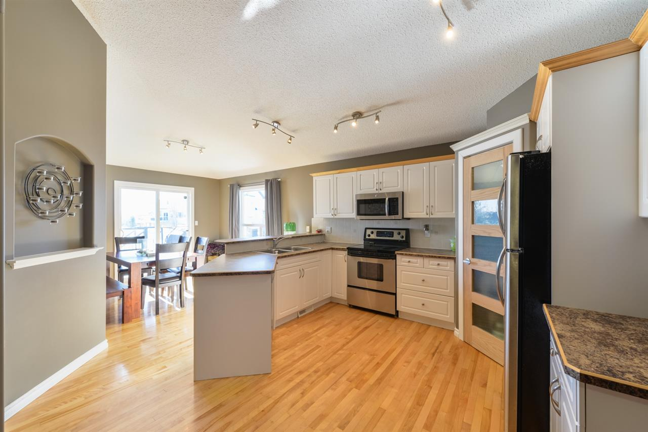 bright kitchen with upgraded appliances, pantry. breakfast bar, sliding door leads to the deck.