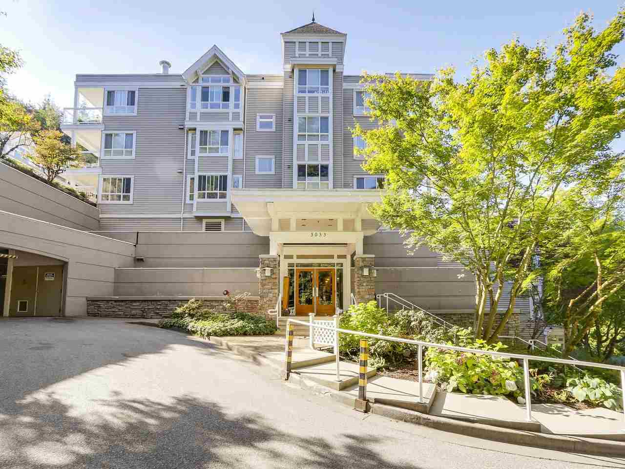 "Main Photo: 203 3033 TERRAVISTA Place in Port Moody: Port Moody Centre Condo for sale in ""THE GLENMORE"" : MLS®# R2210031"