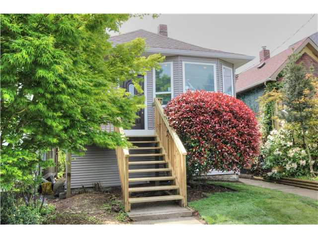 "Main Photo: 1742 E 5TH Avenue in Vancouver: Grandview VE House for sale in ""COMMERCIAL DRIVE"" (Vancouver East)  : MLS® # V1065553"