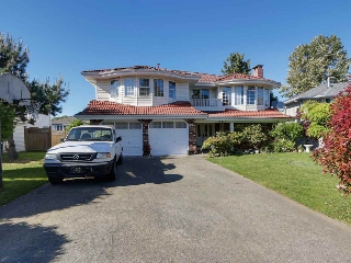 "Main Photo: 12473 69 Avenue in Surrey: West Newton House for sale in ""West Newton"" : MLS(r) # R2066254"