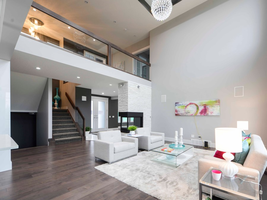 Loft overlooking the great room with 18 ft. ceiling, 3-sided fireplace and 2-storey windows, and opens to the gourmet kitchen.