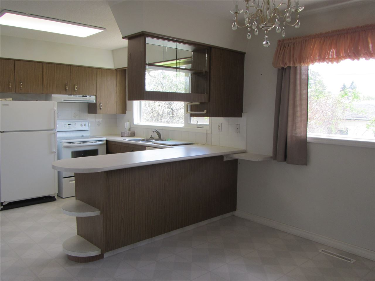 Kitchen opens onto dining area.