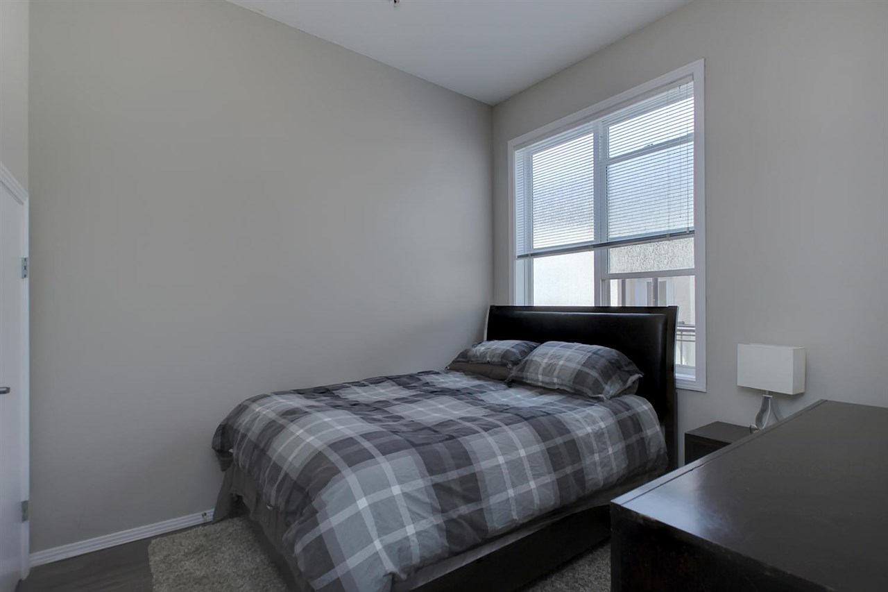 The second bedroom is separated nicely and is located near the entry. The window looks into the centre courtyard and is private. The closet is larger than it looks as it extends under the stairwell leading up to the loft level.