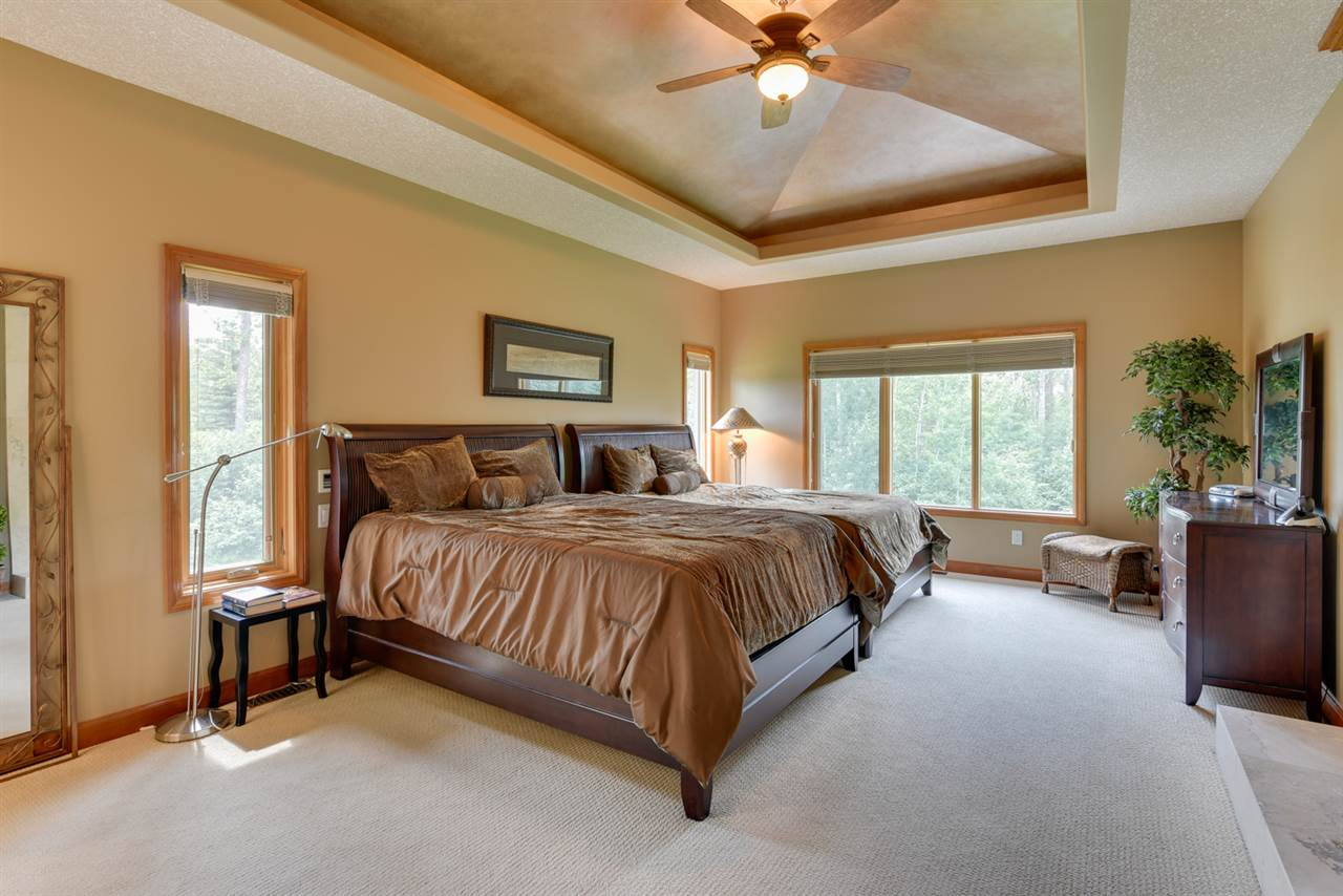 luxurious Master suite that includes a gas fireplace with limestone tile surround, walk in closet and a 5 piece ensuite with rain shower and air tub.