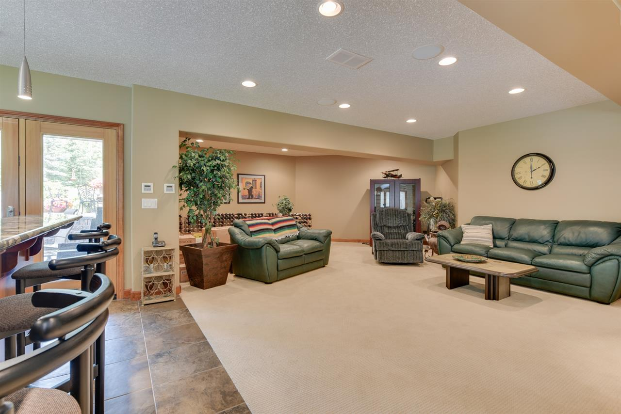 The fully finished walkout basement is just as stunning as the main floor with 2 more bedrooms, 3 piece bathroom with steam shower, 2nd gas fireplace, built in speakers throughout and huge wet bar