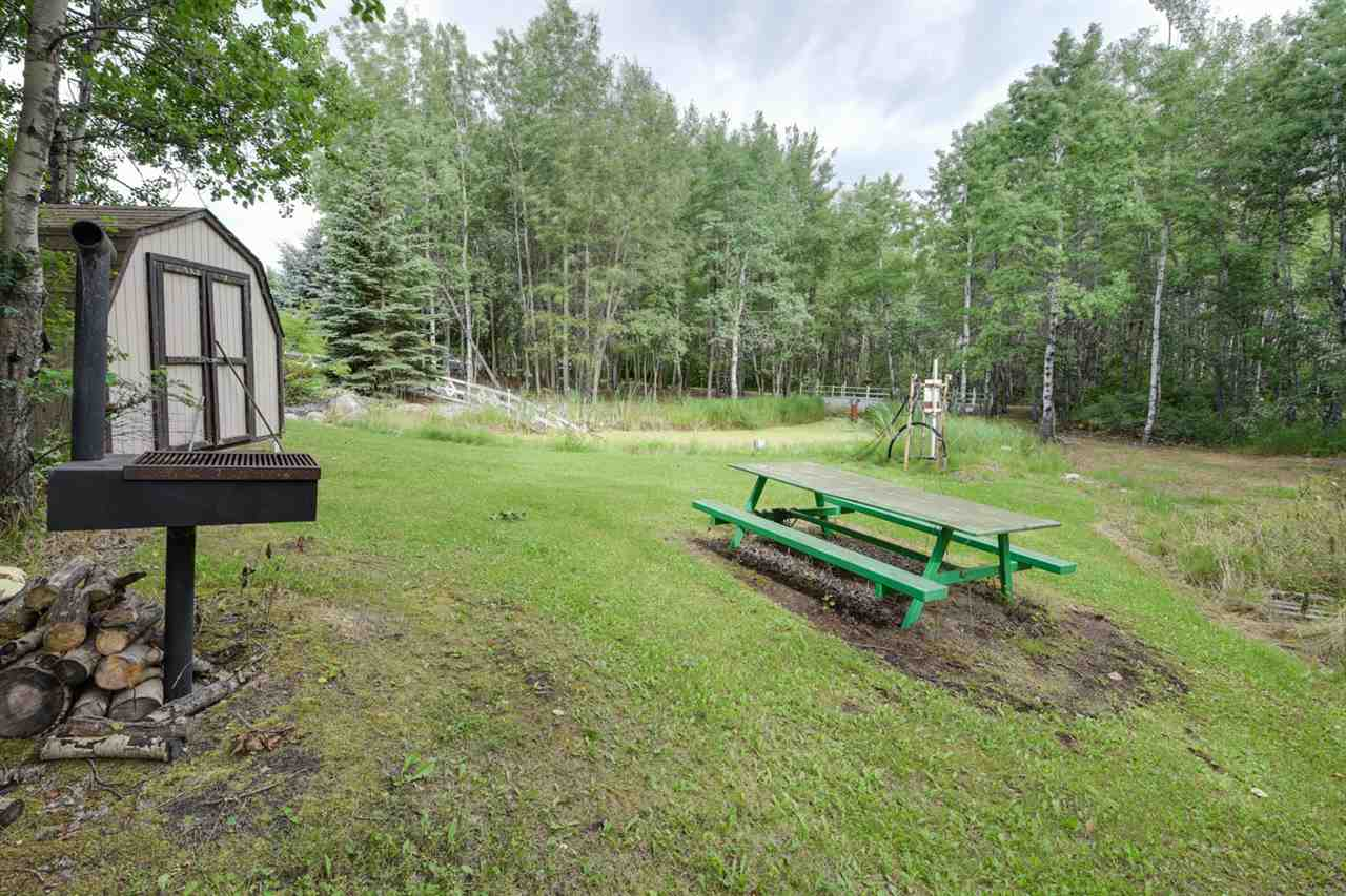 The 5.29 acres are completely landscaped and feature a gazebo, waterfall and bridge making it perfect for a wedding setting.  Other extras include a security gate plus in floor heat in the basement, garage and driveway.
