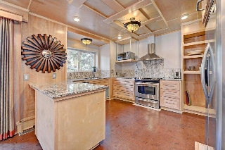 Granite Counters, tiled backsplash, high end custom cabinetry