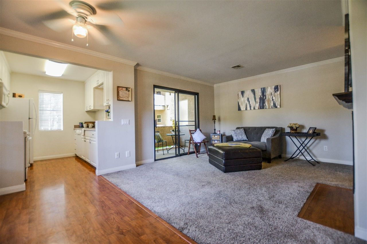 Main Photo: RANCHO PENASQUITOS Condo for sale : 2 bedrooms : 10375 Azuaga St #117 in San Diego