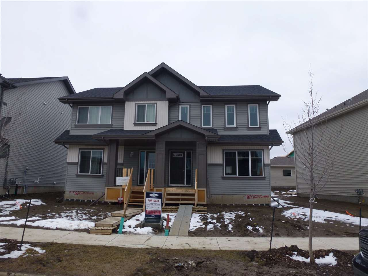 Main Photo: 681 LEWIS GREENS Drive in Edmonton: Zone 58 House Half Duplex for sale : MLS(r) # E4061059