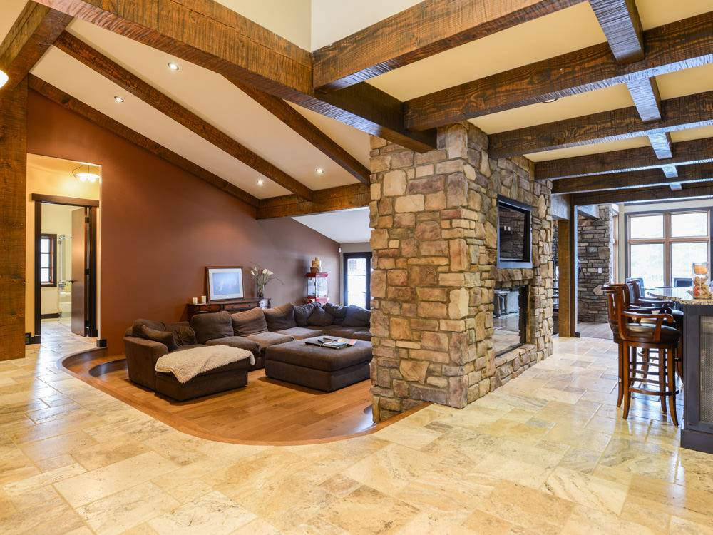 Open concept design showcased imported Douglas Fir posts and beams throughout.
