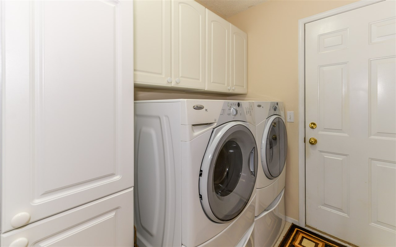 Featuring laundry pair on pedestals and access to attached garage...