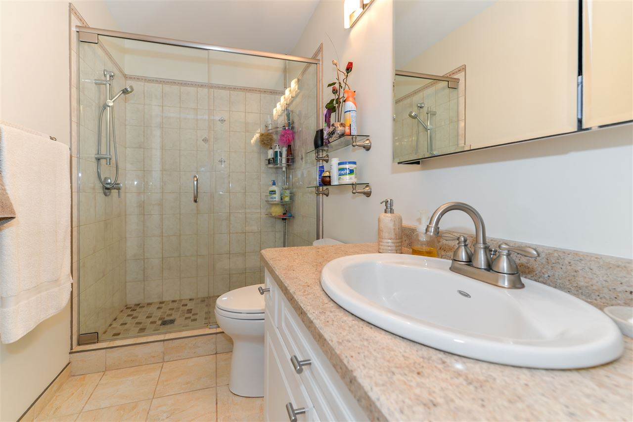 Updated master ensuite with tiled shower and heated floor..