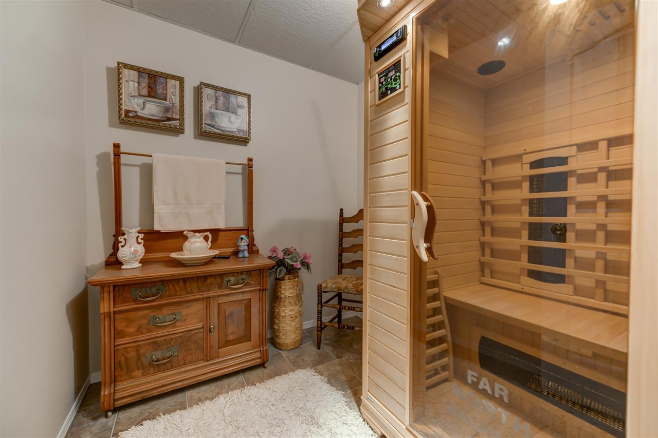 Dedicated sauna room, featuring 2-person infrared sauna with lights and sound...
