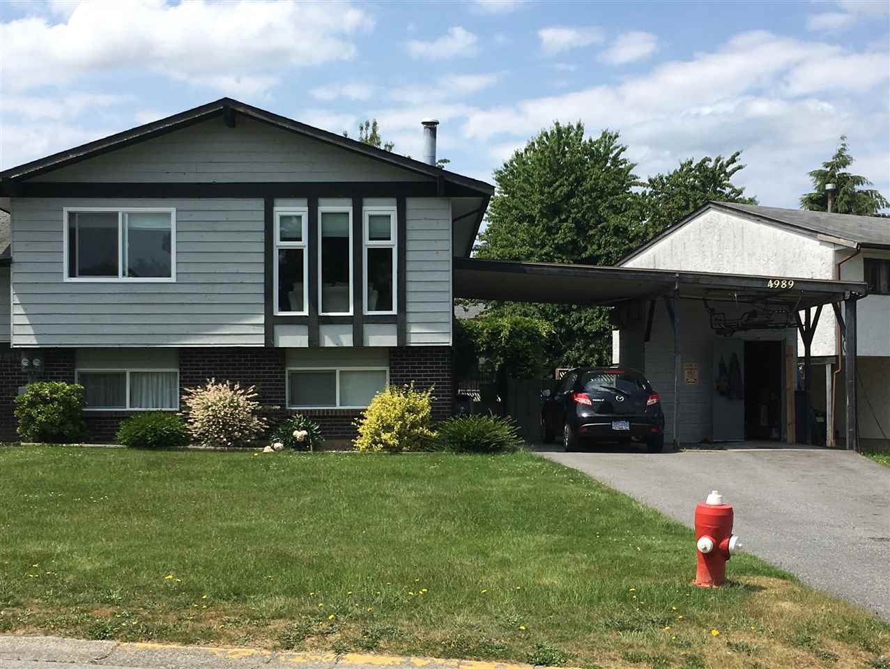 Main Photo: 4989 207A Street in Langley: Langley City House 1/2 Duplex for sale : MLS®# R2277301