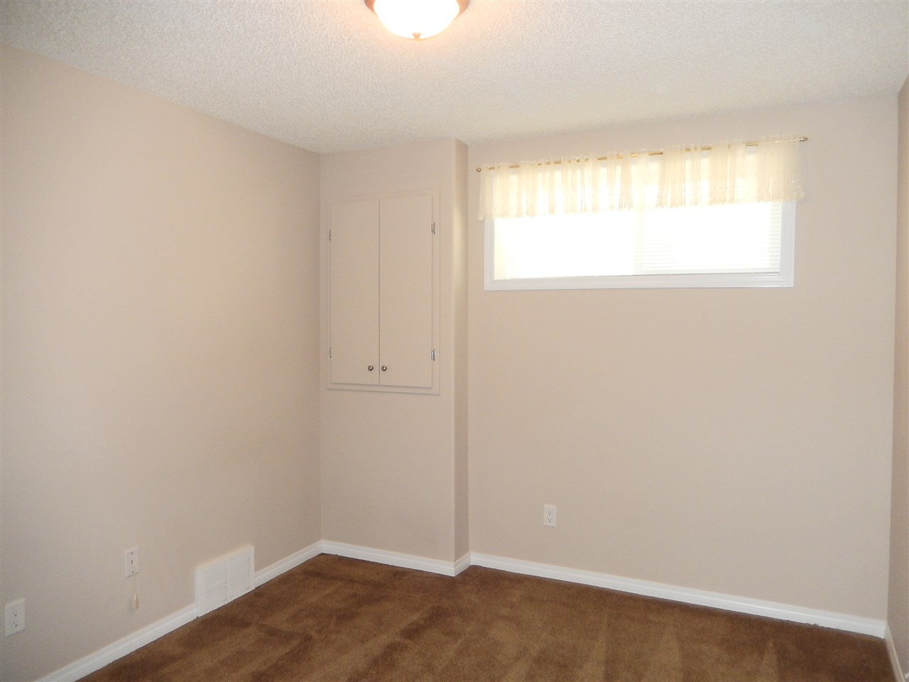 Spare bedroom on the lower level.