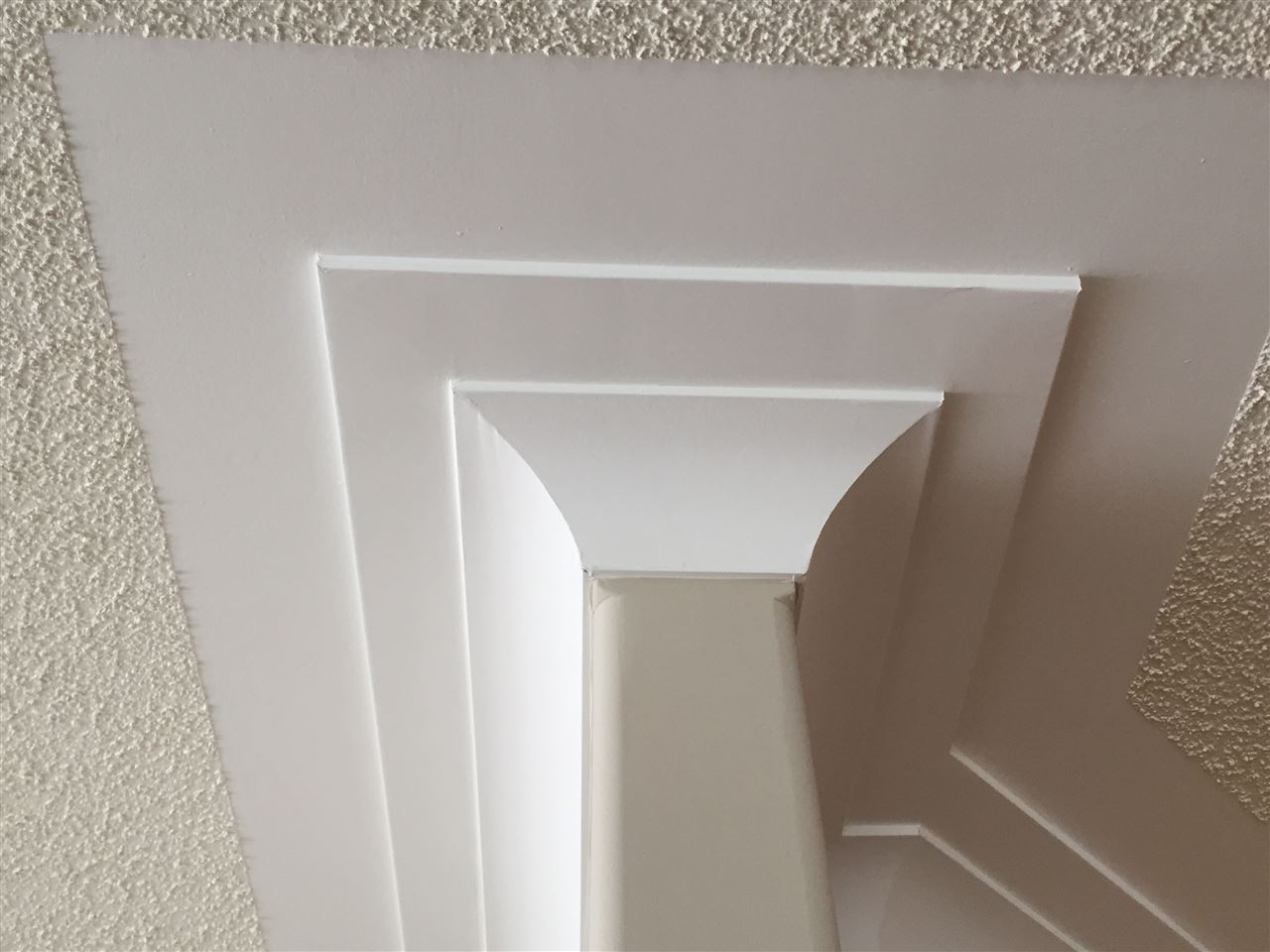 Extensive cove ceiling moldings.