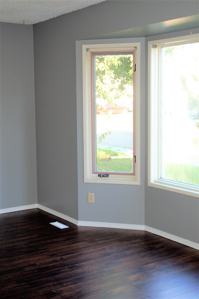 With dark rich laminate flooring.