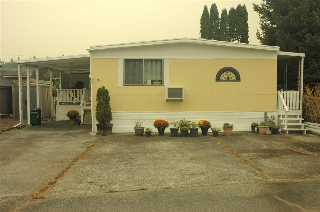 "Main Photo: 99 201 CAYER Street in Coquitlam: Maillardville Manufactured Home for sale in ""WILDWOOD"" : MLS® # R2202648"