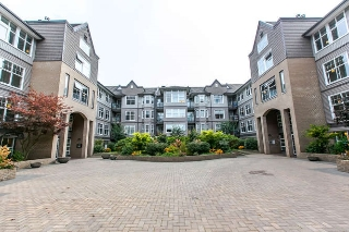 "Main Photo: 121 20200 56 Avenue in Langley: Langley City Condo for sale in ""The Bentley"" : MLS® # R2105499"