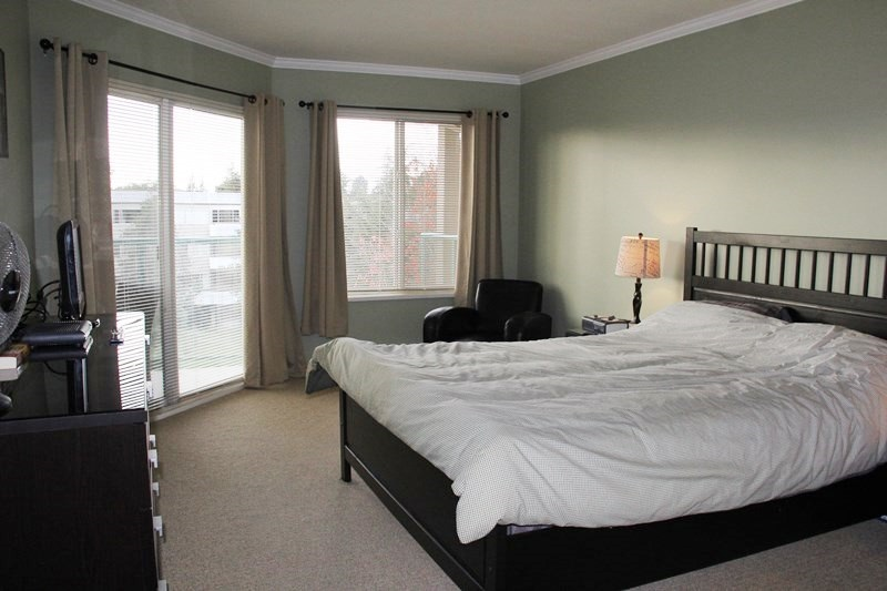 "Photo 6: 404 20453 53 Avenue in Langley: Langley City Condo for sale in ""Countryside Estates"" : MLS(r) # R2120225"