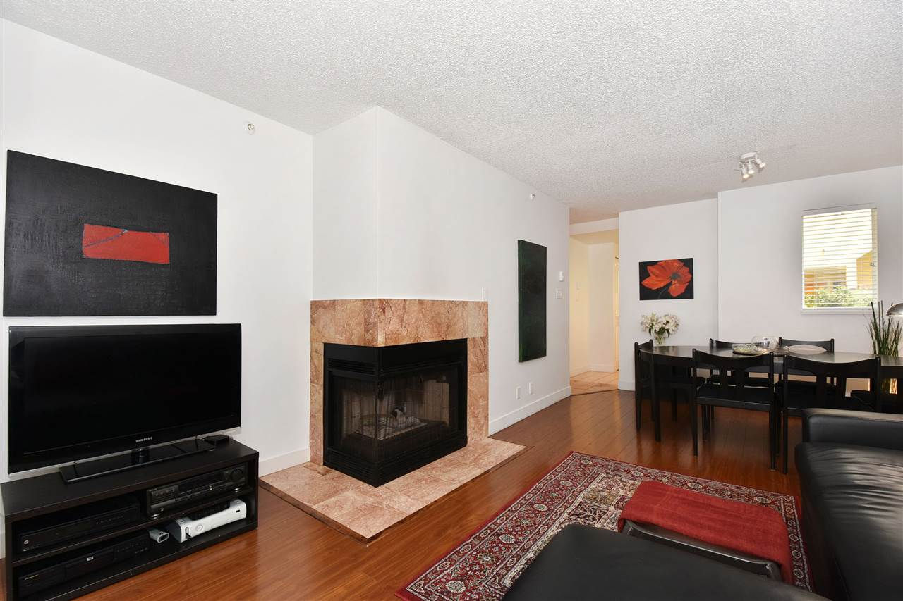 Spacious living and dining area with gas fireplace
