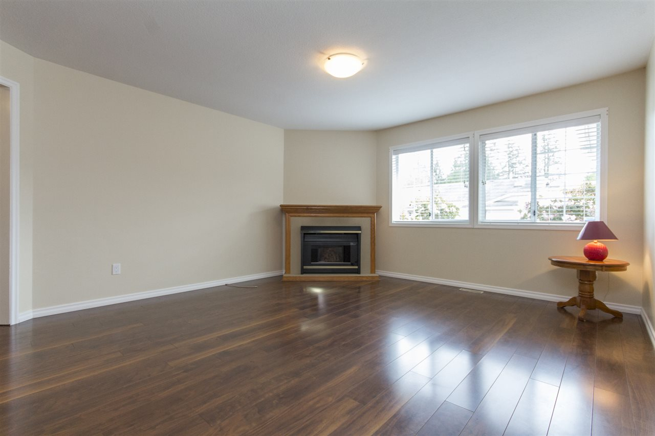 Large Multi use area with a gas Fireplace open to the Kitchen