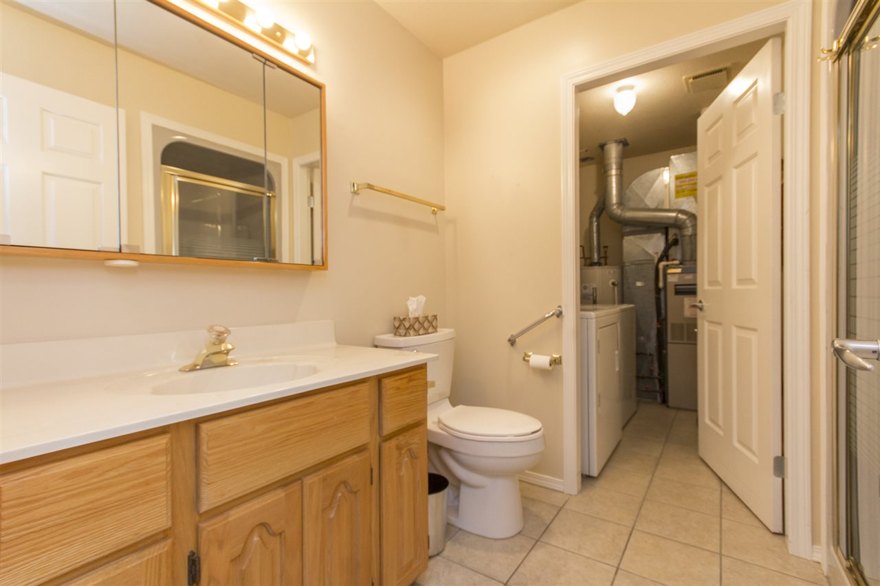 Walk in shower with Laundry room.  Extra storage.