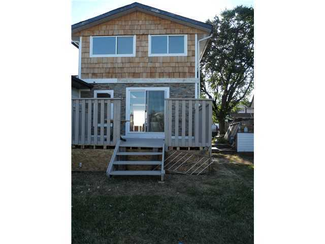 Photo 10: 41 FONDA Crescent SE in Calgary: Fonda Residential Attached for sale : MLS(r) # C3646765